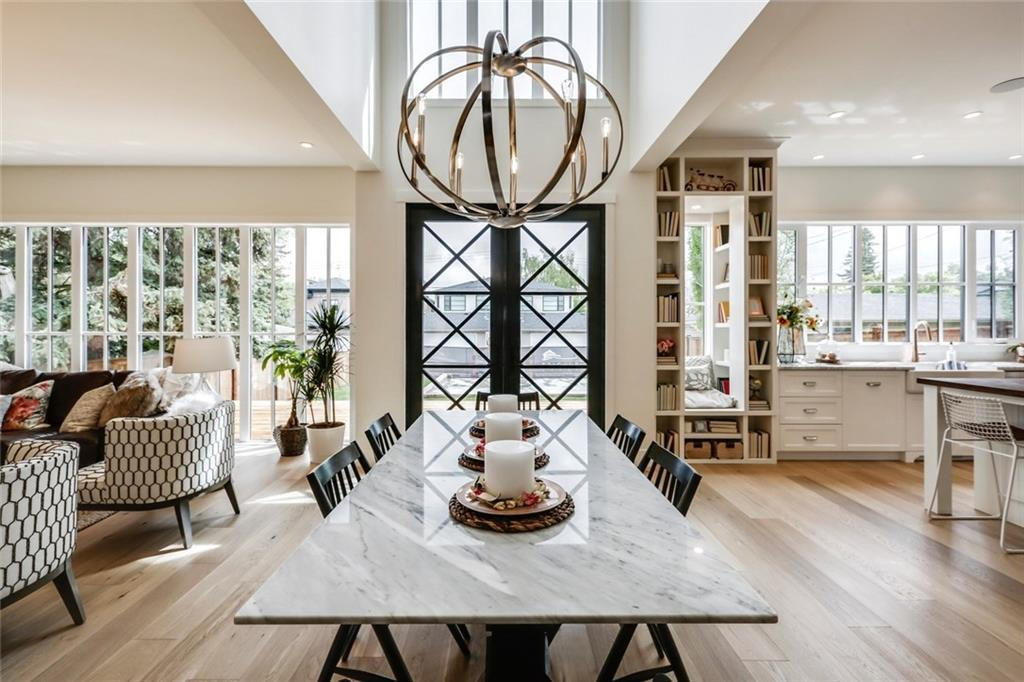 Trickle Creek Homes Calgary The Maxwell Show Home, Modern Farmhouse, Open Concept Main Floor, Dining Room, Wine Cellar