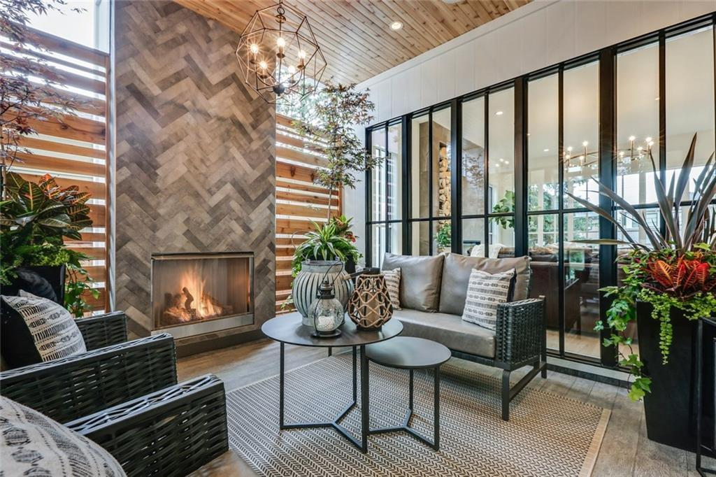 Trickle Creek Homes Custom Home The Maxwell Modern Farmhouse Home Outdoor Living Room Gas fireplace wood ceiling patio furniture