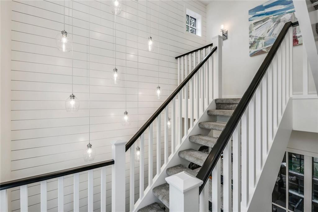 Trickle Creek Homes Custom Home The Maxwell Modern Farmhouse Home Stairwell details Open stair risers
