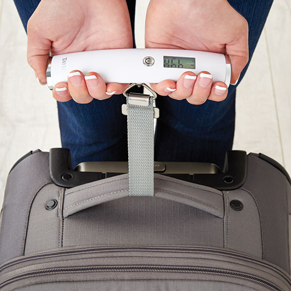 5 Must-Pack Things For Every Trip, Savvy Traveler Tips, What to Pack, luggage scale, two handed luggage scale, digital luggage scale