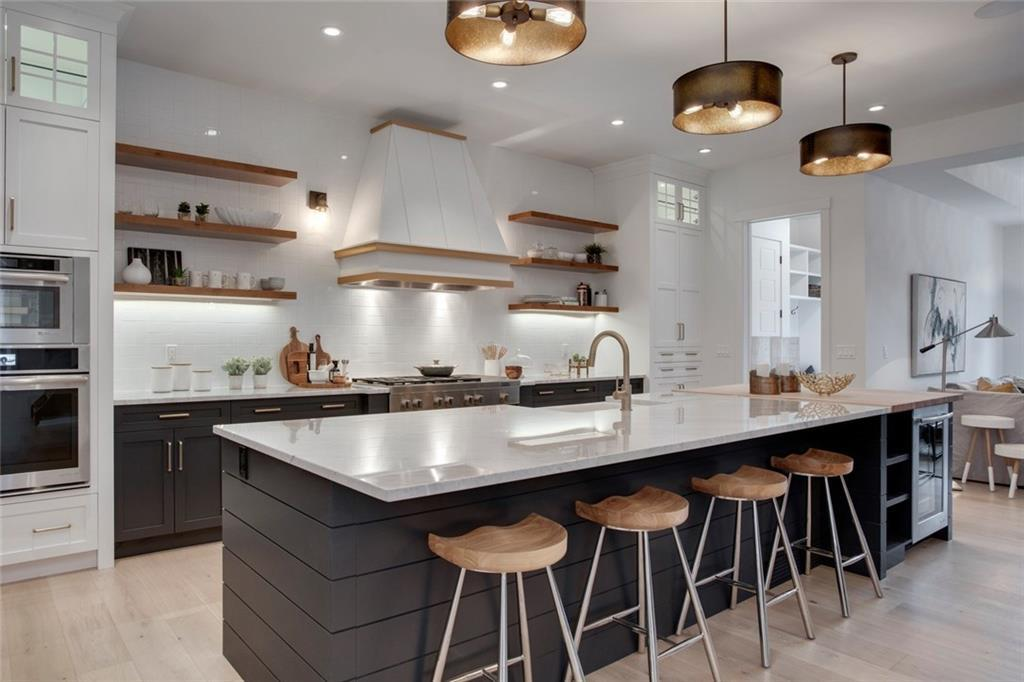 Trickle Creek Homes Magnolia Modern Farmhouse Kitchen, Butcher Block Counters, Marble Countertop, Wooden Open Shelving, Chef's Kitchen, Modern Appliances, Kitchen with Large Island