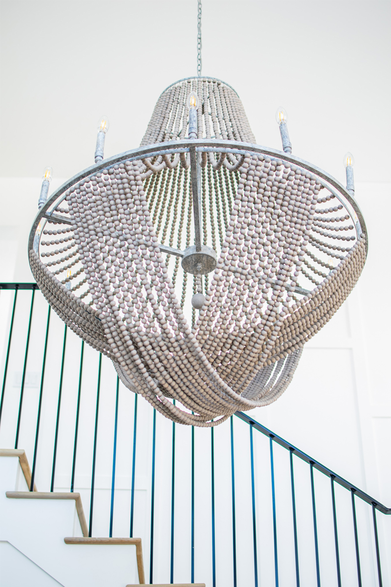 stairwell chandelier, beachy chandelier, wood bead chandelier, grand light fixture, beach chic chandelier, beach home style, grand entrance lighting, stairwell lighting, staircase chandelier