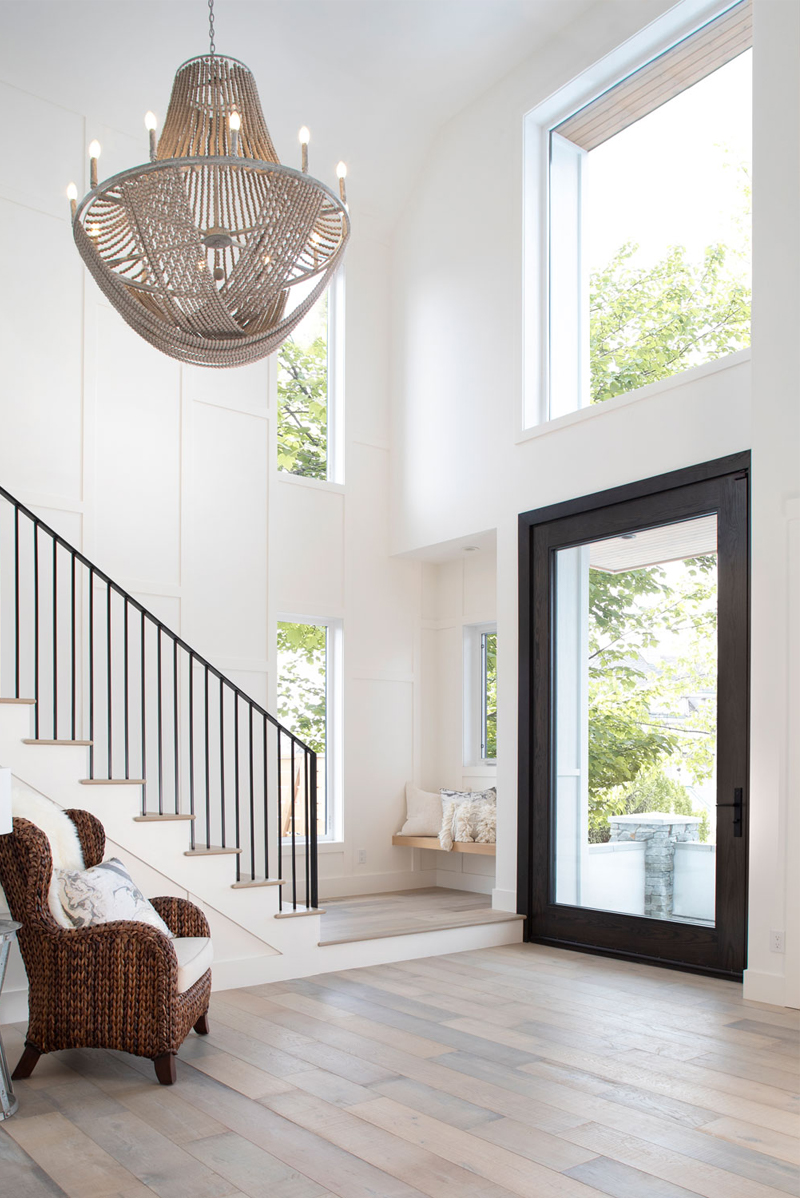 Grand Entrance, Spacious entryway, beach chic home, stairwell chandelier, luxe chandelier, casual chandelier, elegant beachy home, beachy style, stairwell inspo, staircase ideas