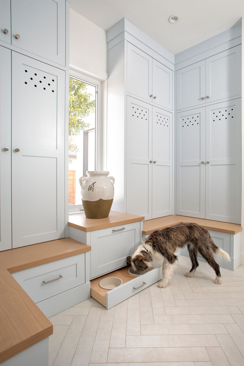 mud room cabinetry, mud room pet space, hidden pet dishes, custom cabinetry mud room, mud room paint colour ideas, mud room painted cabinets, mud room blue cabinets, herringbone tile floors, mud room floors