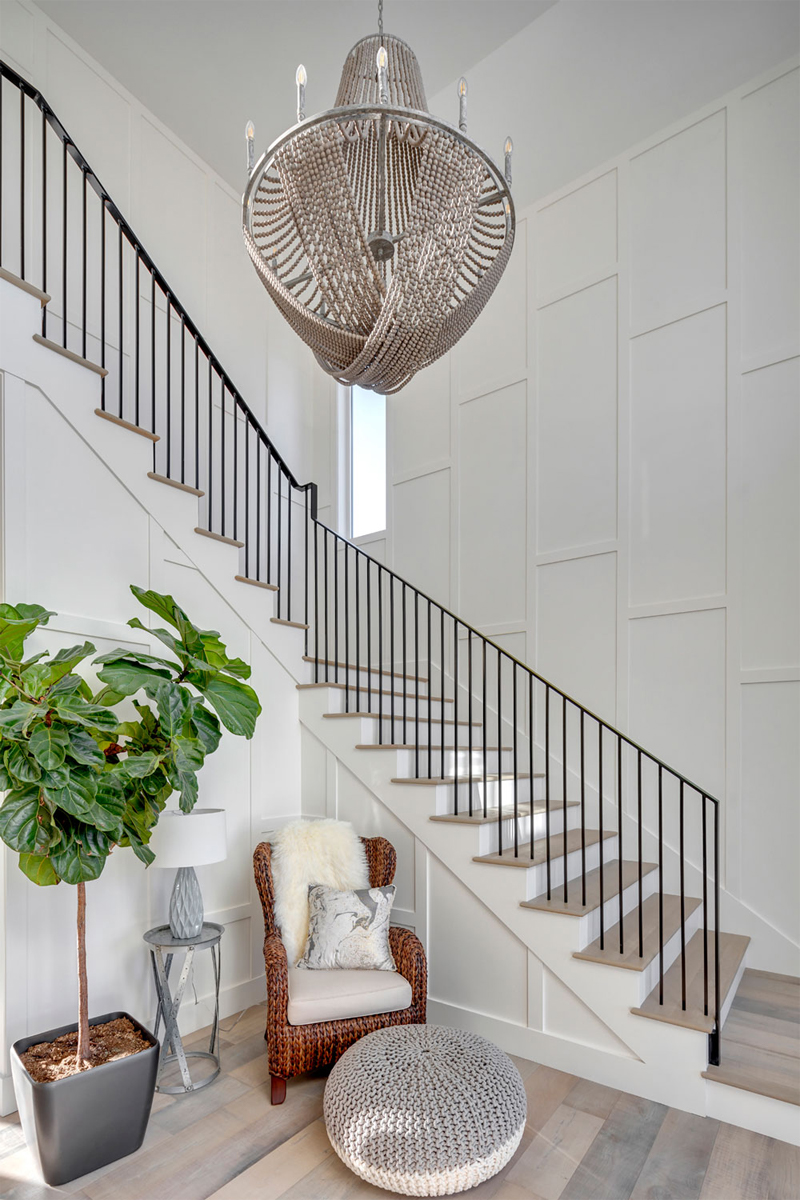 Grand Entrance, Spacious entryway, beach chic home, stairwell chandelier, luxe chandelier, casual chandelier, elegant beachy home, beachy style, stairwell inspo, staircase ideas, custom millwork stairs