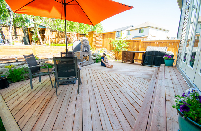 chevron patterned deck, large deck design, outdoor kitchen, herringbone patterned deck, wood fired pizza oven, backyard deck design