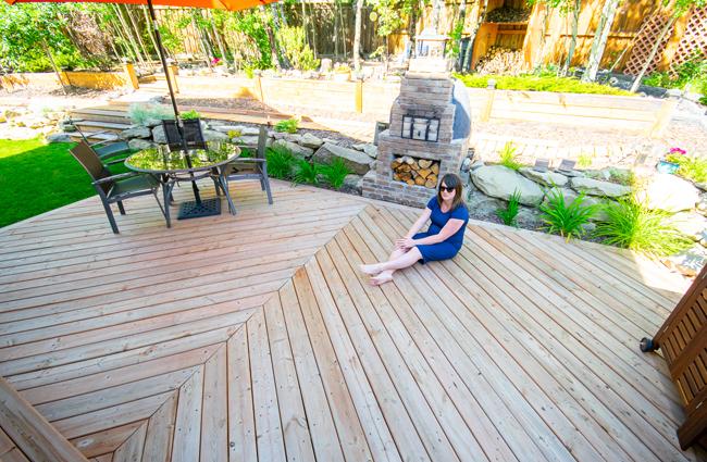chevron patterned deck, large deck design, outdoor kitchen, herringbone patterned deck, wood fired pizza oven, backyard deck design
