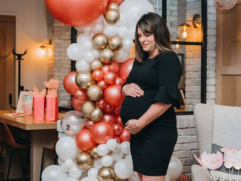 baby shower, non traditional baby shower, baby shower balloon arch, pink blush maternity dress, distilled beauty bar yyc, nicole constante photography