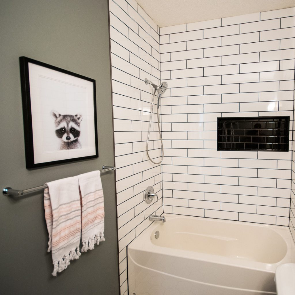 baby bathroom ideas, bathroom renovation ideas, bathroom renovation inspo, subway tile tub surround, subway tile shower niche, black and white bathroom, kids bathroom design