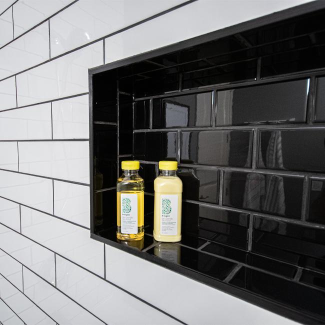 bathroom makeover, bathroom before and after, subway tile shower, shower niche, hex tile floor, tile source calgary, main bathroom, black and white bathroom, bathroom tile