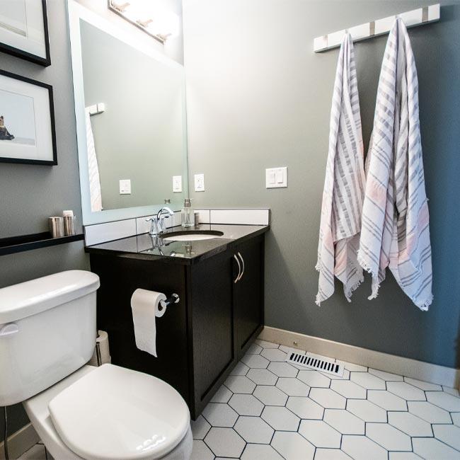 bathroom makeover, bathroom before and after, subway tile shower, shower niche, hex tile floor, tile source calgary, main bathroom, black and white bathroom, bathroom tile, shower tile, tub surround tile, classic bathroom design, bathroom renovation