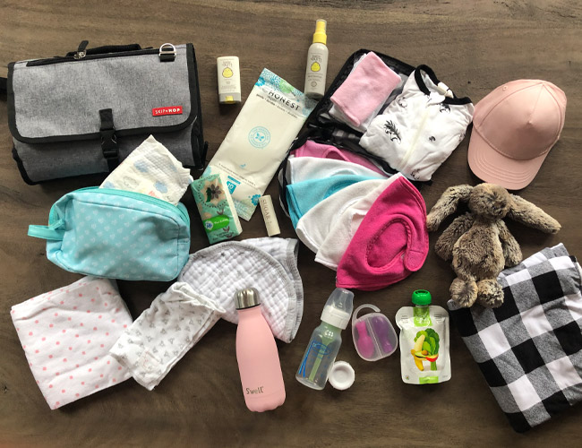 what to pack in your diaper bag, diaper bag essentials, baby changing essentials, what to pack for baby, day out with baby essentials, diaper bag must have items, what to pack in your diaper bag