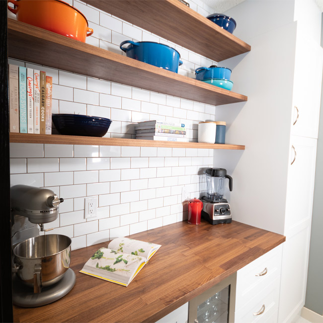 open shelving pantry, farmhouse pantry, custom floating shelves, diy floating shelves, walnut floating shelves, butlers plantry, subway tile pantry, walnut butcher block counter, ikea counter, ikea countertop, le creuset cookware, how to display le creuset cookware, how to display cookware, shelf styling pantry, pantry shelf style, pantry shelfie, cookbook display, coffee bar, kitch custom shelves