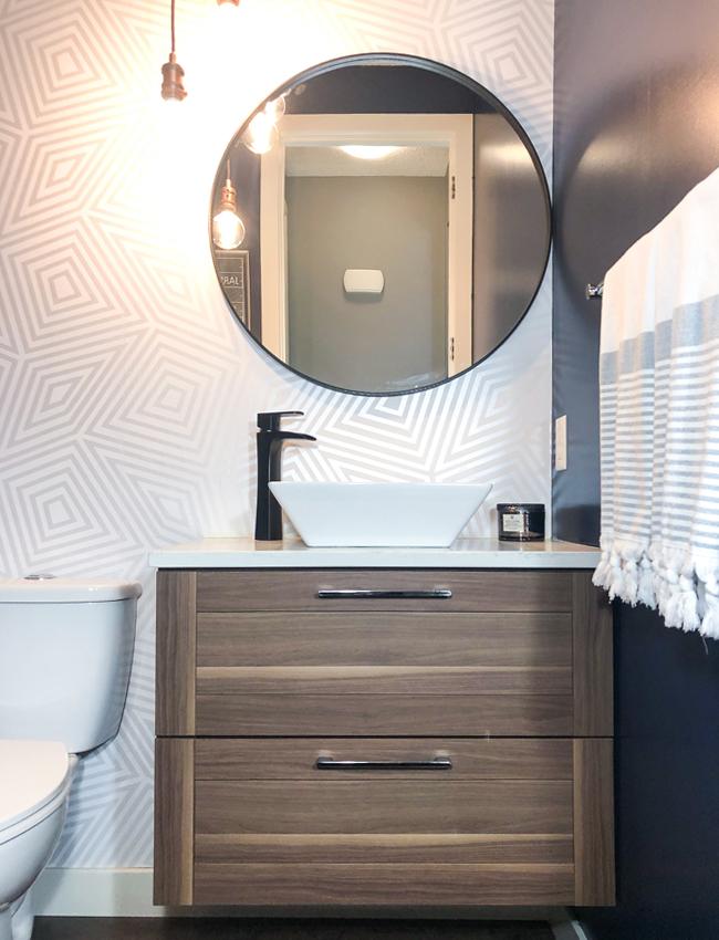 round bathroom mirror over sink