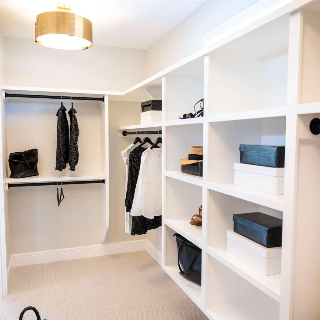 white closet shelves with clothing