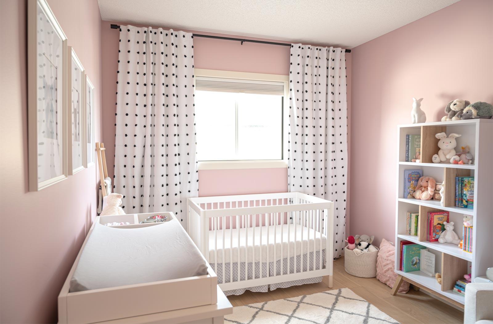 pink nursery, feminine nursery, baby girl room, baby girl nursery, white crib, white crib pink walls, pink walls nursery, modern feminine nursery, modern girls room, modern baby girl room, pompom curtains nursery