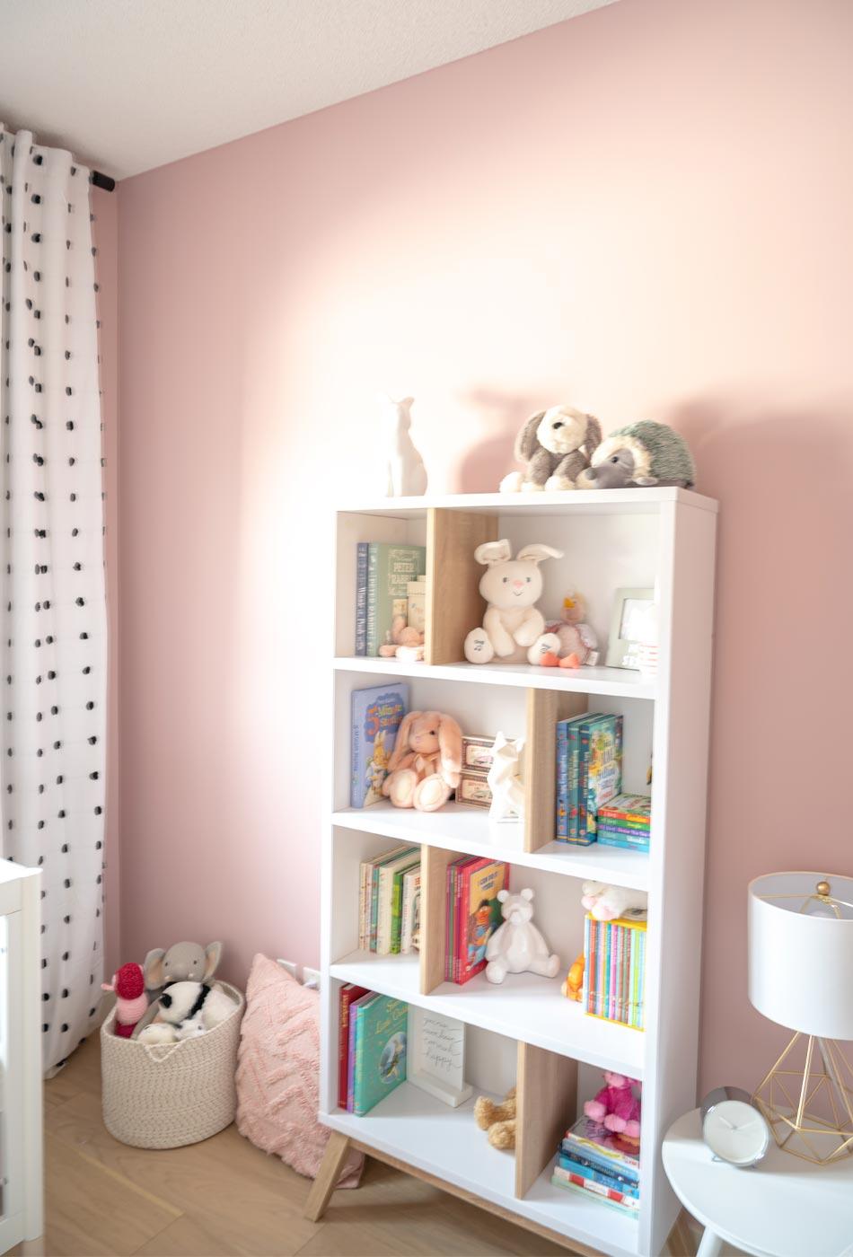 pink nursery, feminine nursery, baby girl room, baby girl nursery, white crib, white crib pink walls, pink walls nursery, modern feminine nursery, modern girls room, modern baby girl room, pompom curtains nursery, IKEA PAX Wardrobe hack, IKEA PAX Wardrobe nursery closet, nursery book case, baby room bookcase, midcentury modern bookcase